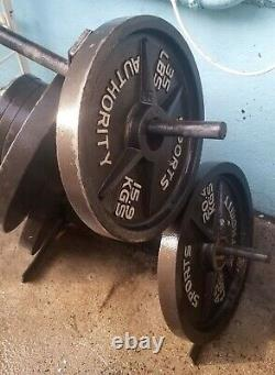 180 lbs weight plate set with stand (2) 45lb, (2) 35lb, (4)5lb Local pickup