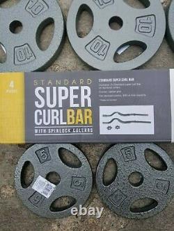 Cap Curl Bar + 60lbs Total Cap Plaques (4)10lbs (4) 5lbs 1 Curl Bar 4 Pc Ensemble
